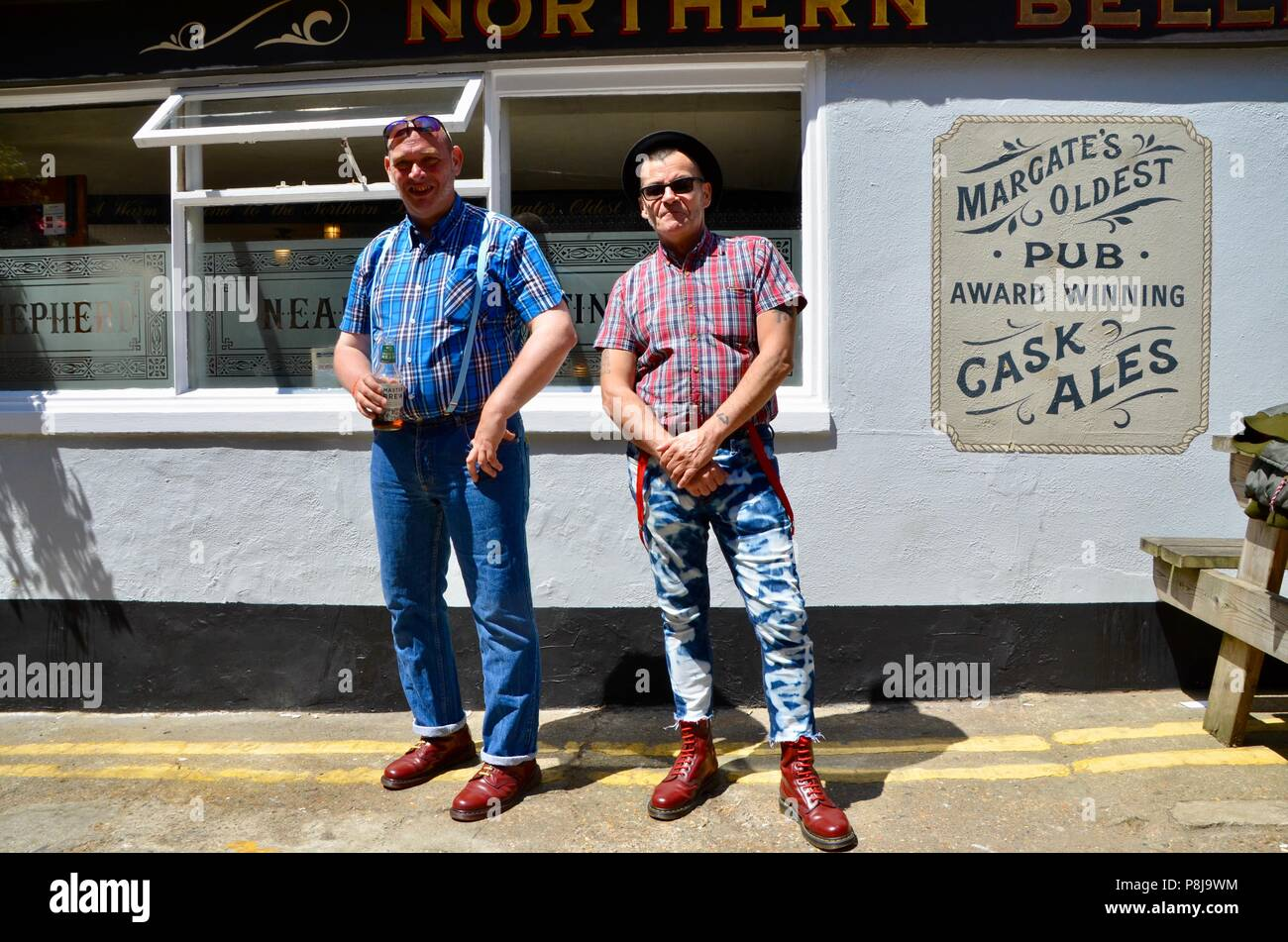 two old skinheads pose outside the northern belle pub margate kent UK - Stock Image