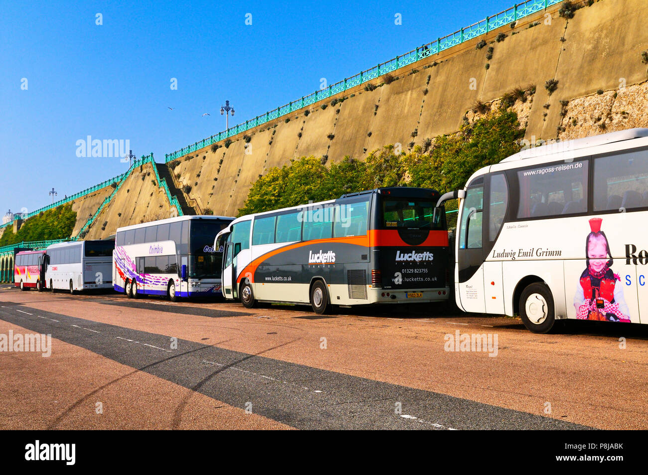 European coaches parked along Madeira Drive on Brighton seafront, East Sussex, England, UK - Stock Image