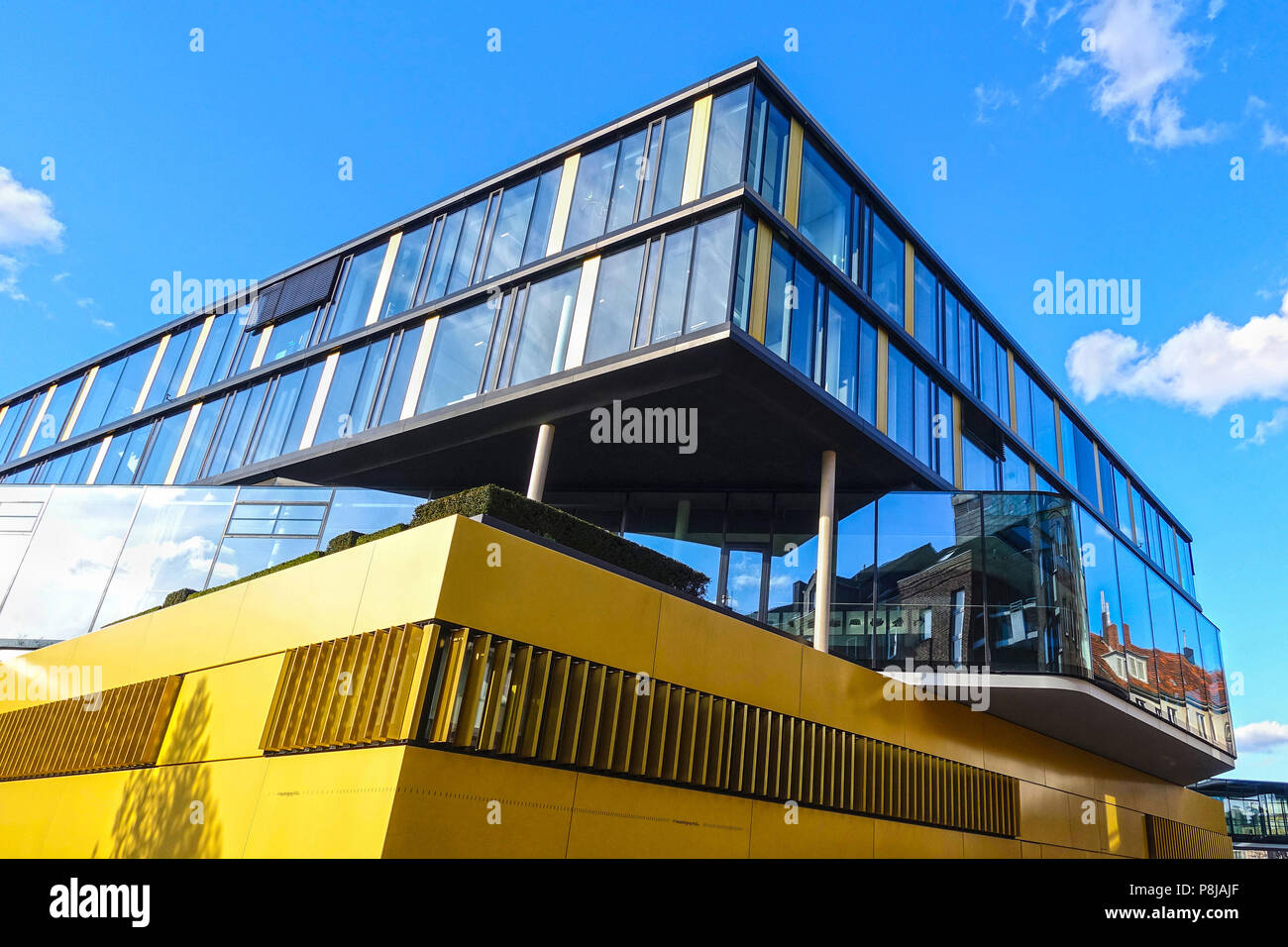 AACHEN, GERMANY - MARCH 29, 2018: Street view of the modern office building of the headquarter of the AachenMünchener insurance company, Aachen. - Stock Image