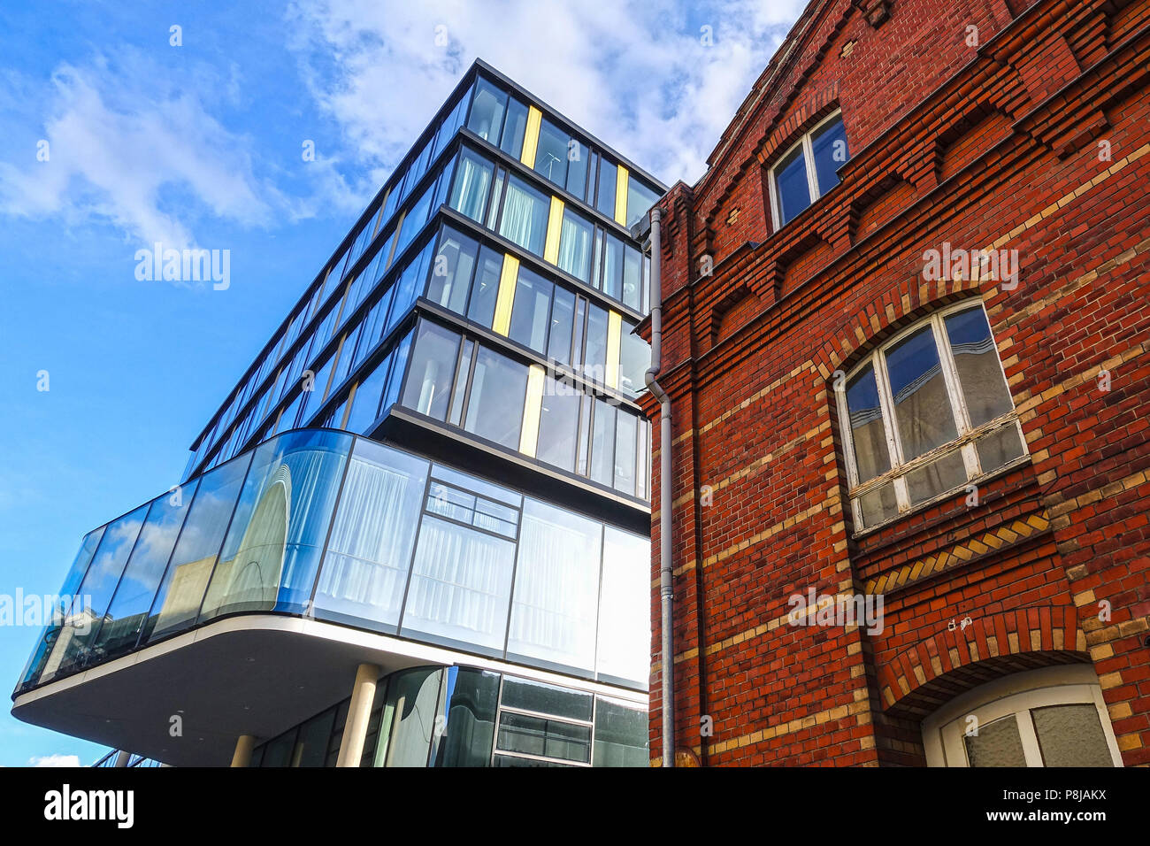 AACHEN, NRW / GERMANY - MARCH 29, 2018: Street view of the modern building of the AachenMuenchener insurance company, made by kadawittfeldarchitektur. - Stock Image