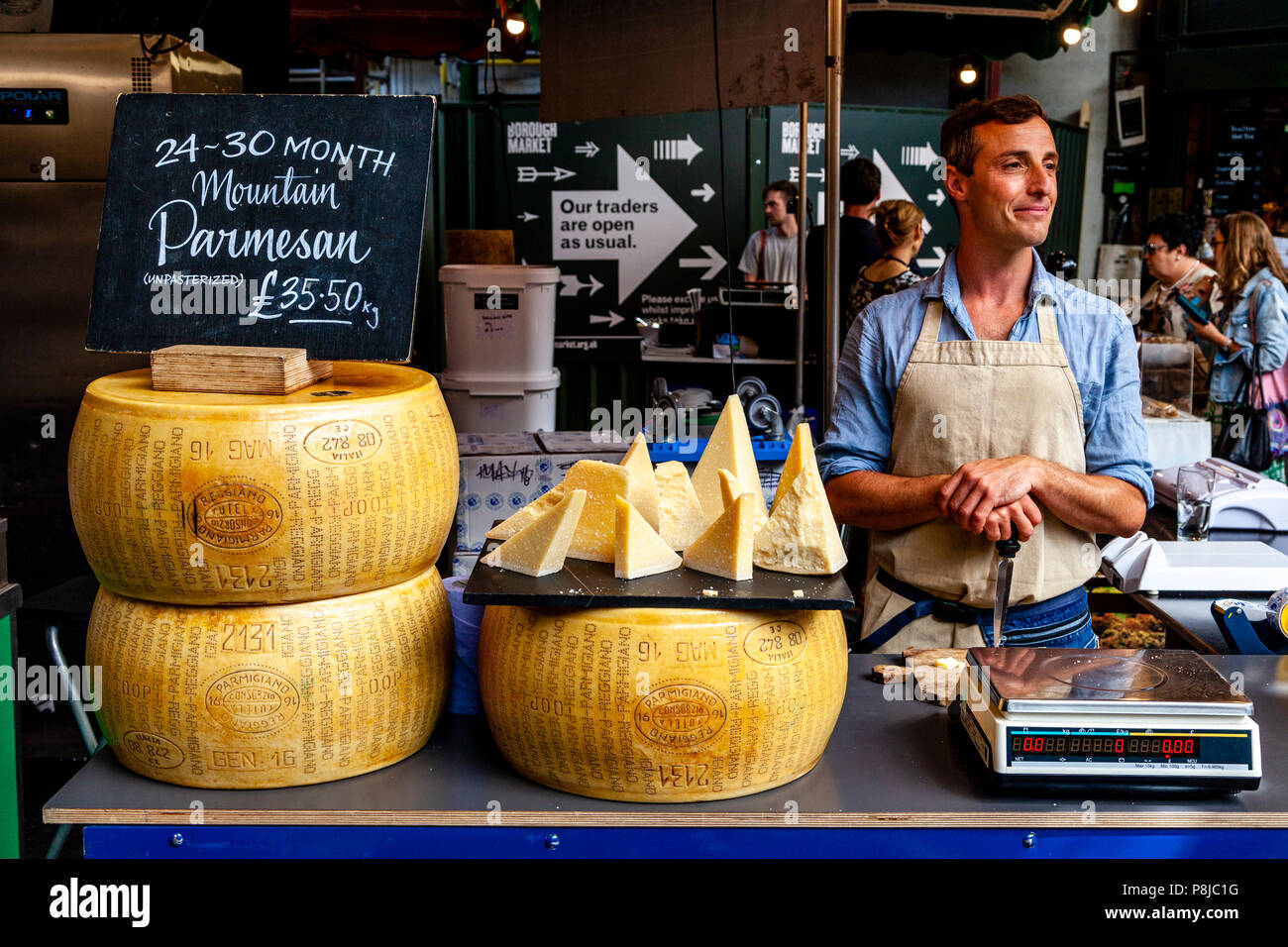 A Man Selling Cheese At A Cheese Stall In Borough Market, London, England - Stock Image