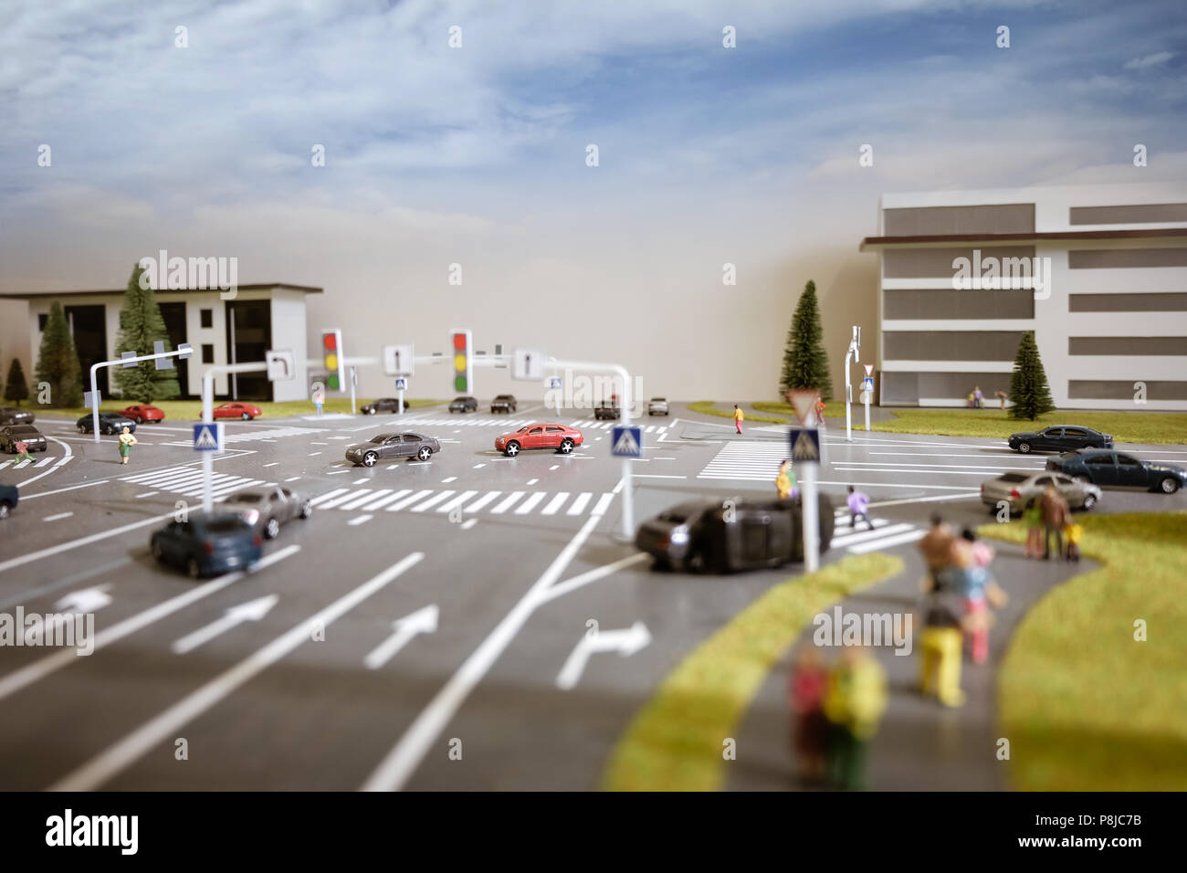 Toy model of a crossroad and traffic collision - Stock Image