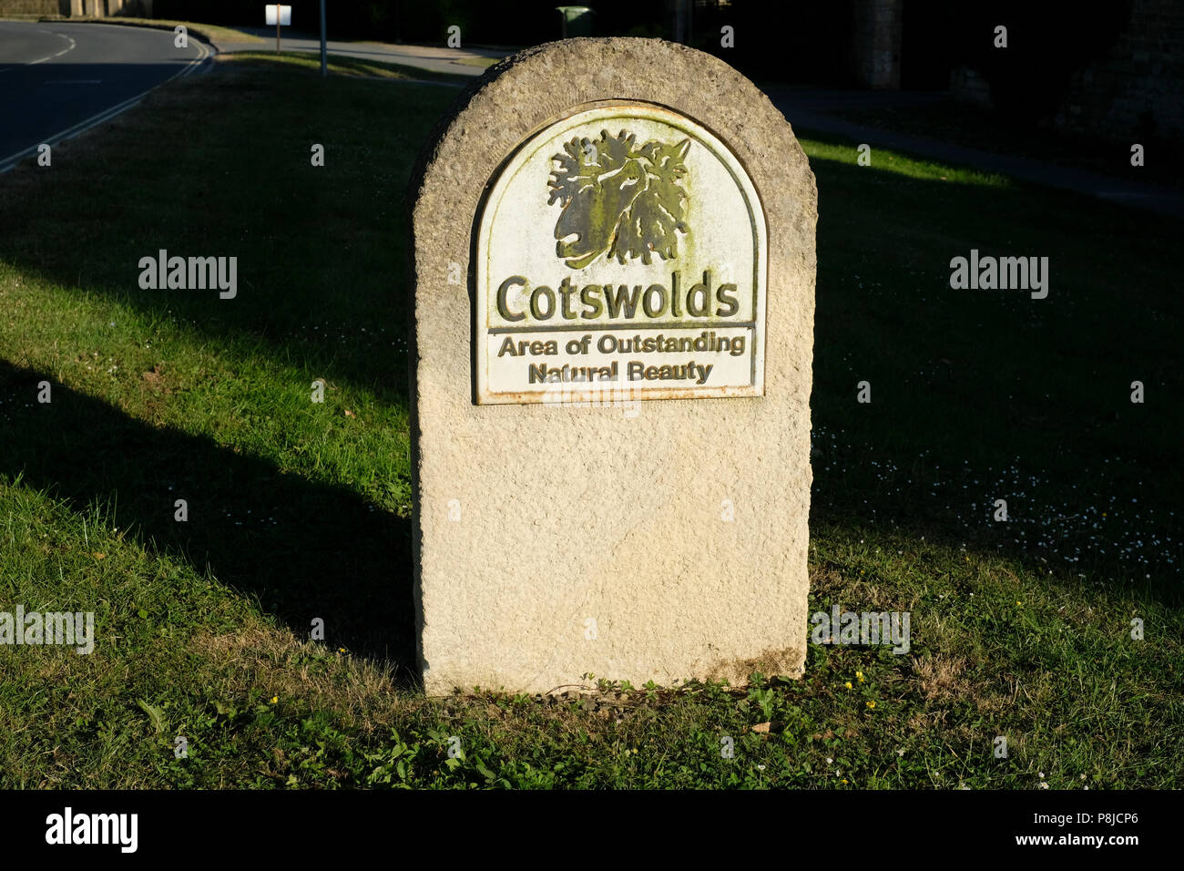 The Cotswolds Area of Outstanding Natural Beauty marker stone on the edge of Broadway village - Stock Image
