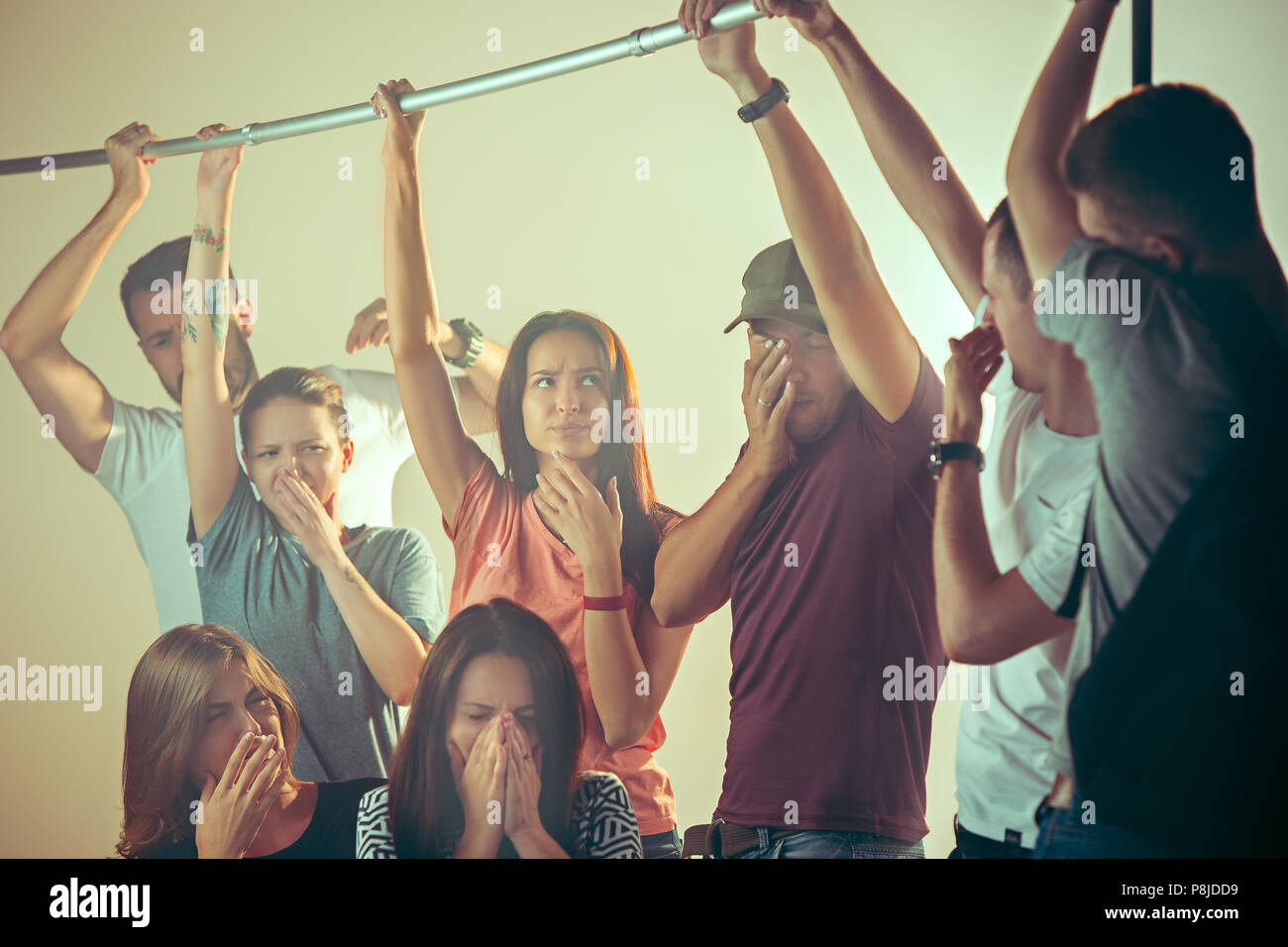Sweaty armpits. Sweaty man. Bus. Public transport. The unhappy people near man - Stock Image