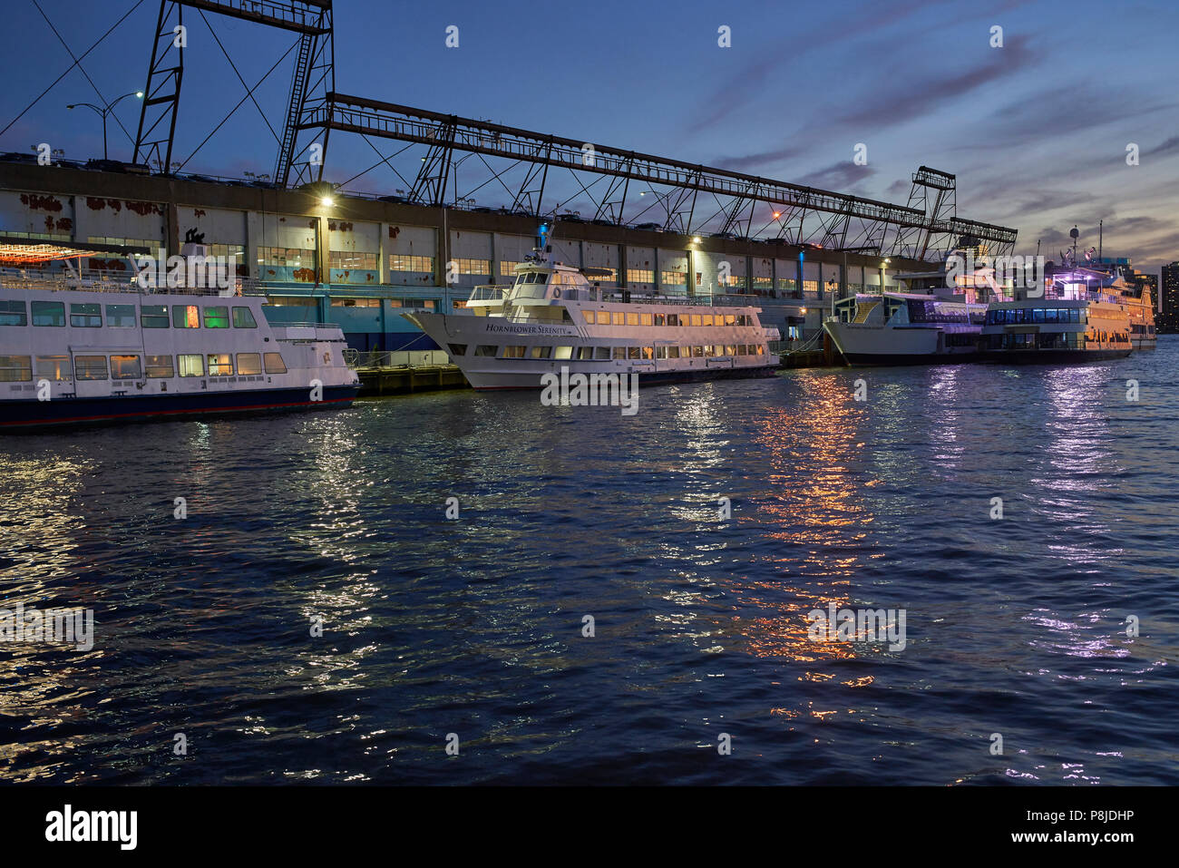 yachts docked at dusk, Hudson River Park, pier 40 in New York City - Stock Image