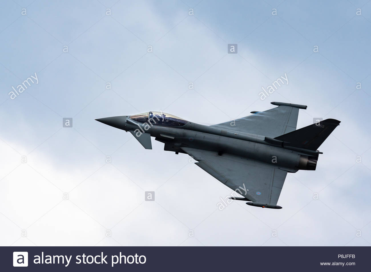 An image of a RAF Typhoon Euro Fighter taking off, full afterburners, vertical - Stock Image