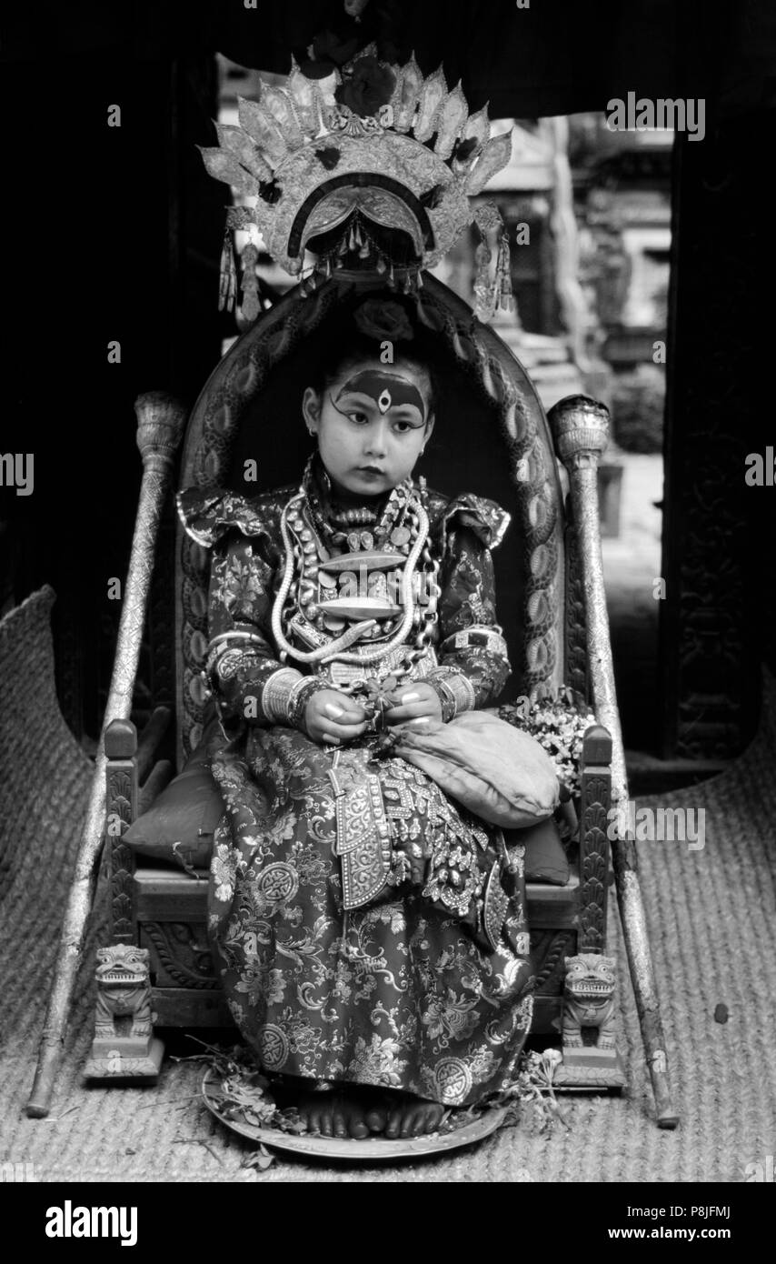The LIVING GODDESS in her full regalia sits on her thrown during the Rato Machendranath Festival - PATTAN, NEPAL Stock Photo