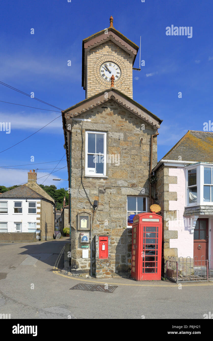 Harbour Office with post box and telephone kiosk in front, Mousehole, Cornwall, England, UK. - Stock Image