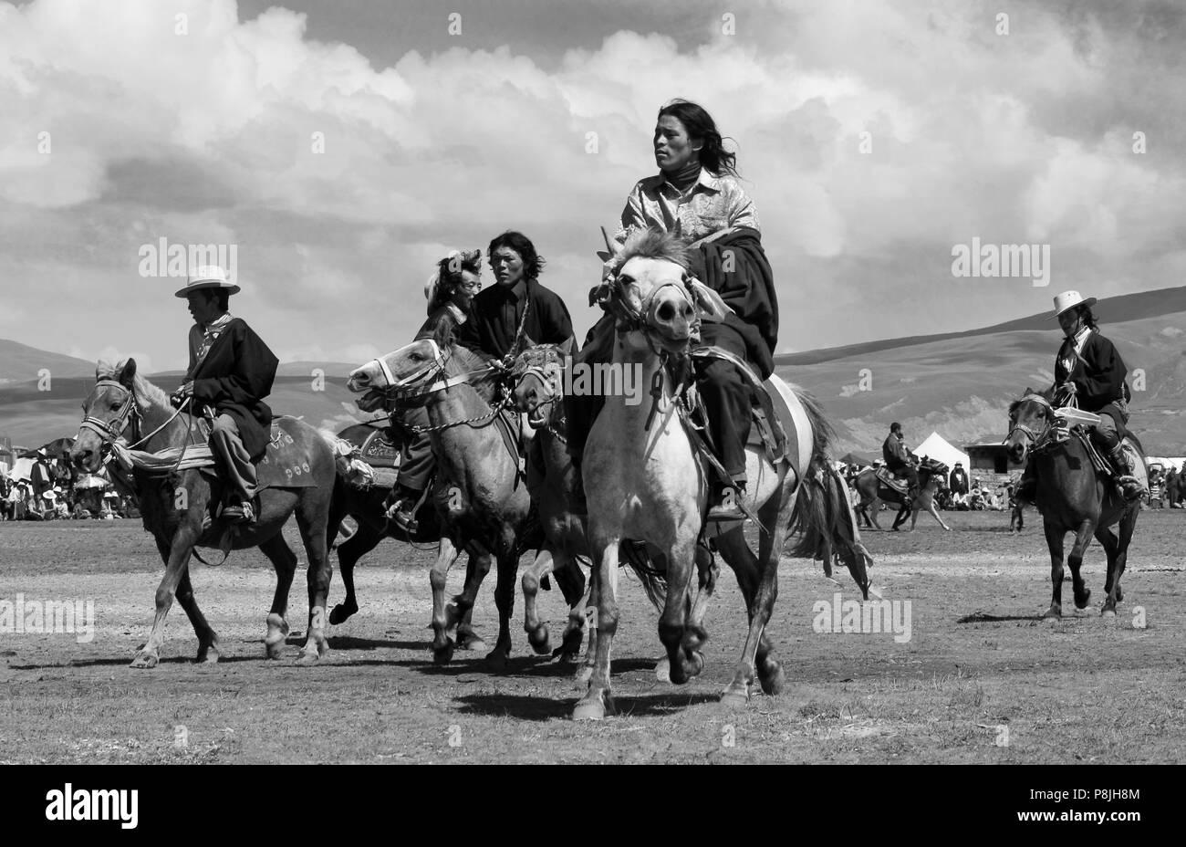 Khampas, the warrior horseman of old Tibet,  compete at the Litang Horse Festival - Kham, Sichuan Province, China, (Tibet) - Stock Image