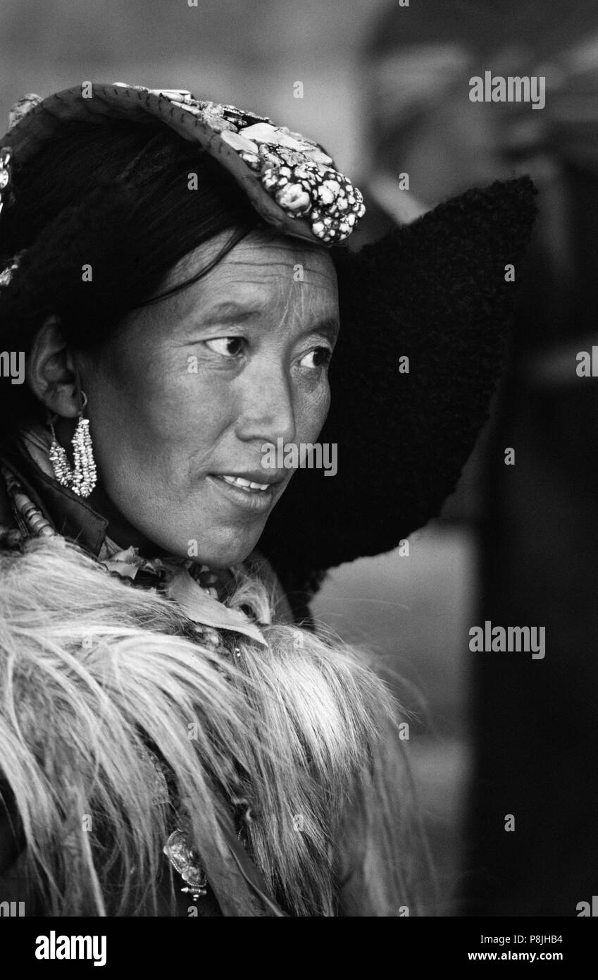 LADAKHI WOMAN showing familial wealth via her PERAK, traditional head piece of silver, coral and TURQUOISE - LADAKH, INDIA - Stock Image