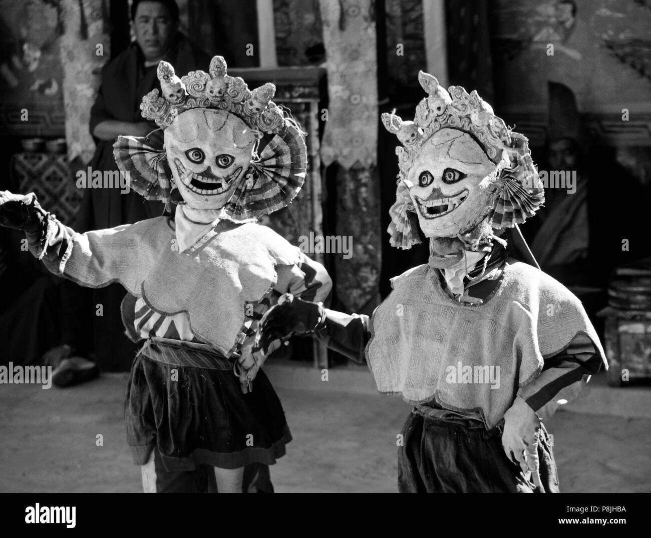 SKULL MASK DANCERS, representing non-attachment, and used as comic relief, TIKSE Monastery Masked Dances - LADAKH, INDIA - Stock Image