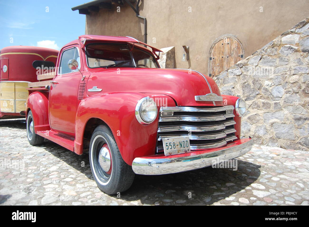 Old fancy shiny red truck - Stock Image