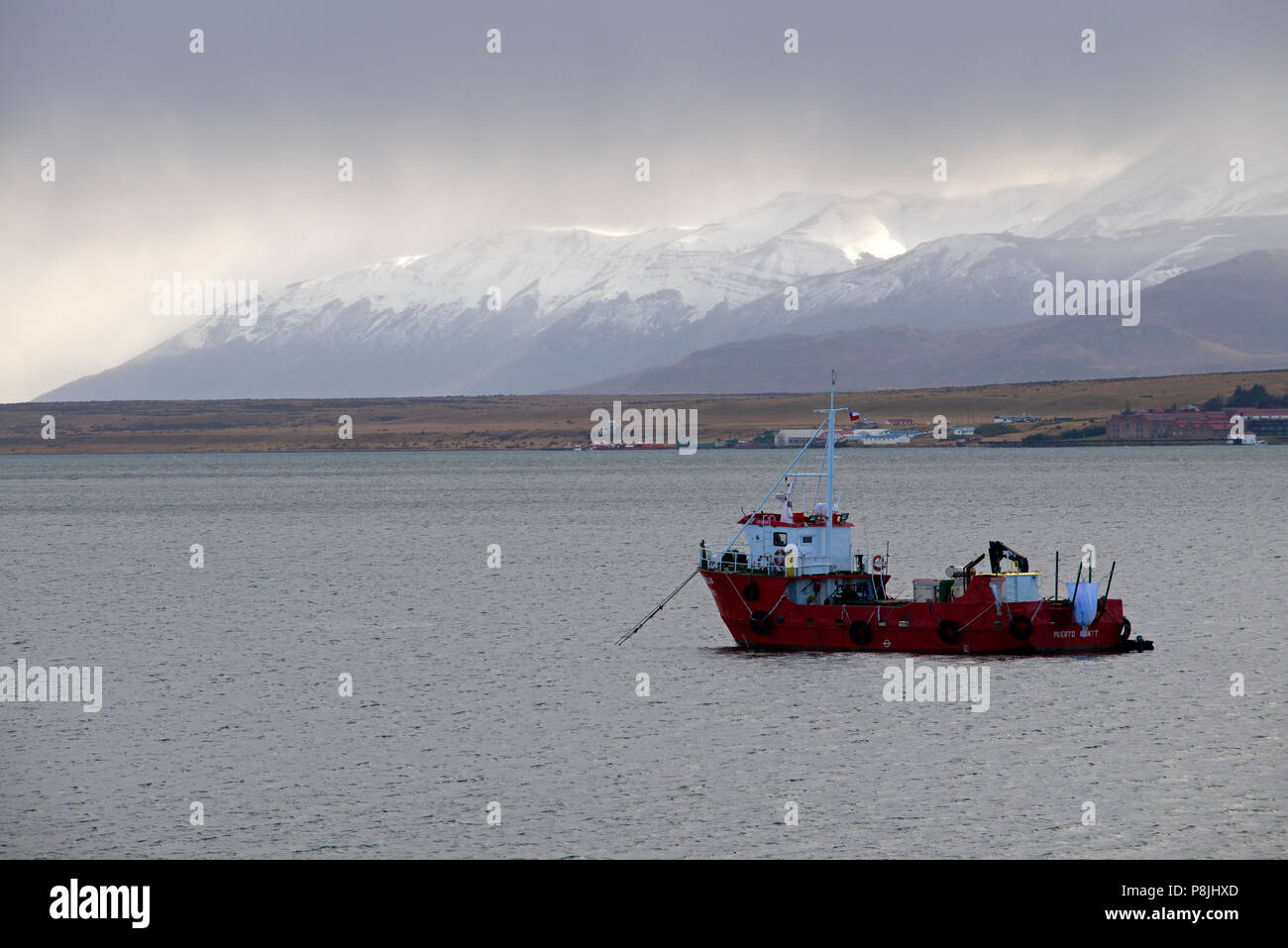 Fishing boat anchored in the waters of the Last Hope Sound, near the fishing port of Puerto Natales, in southern Chile. Stock Photo