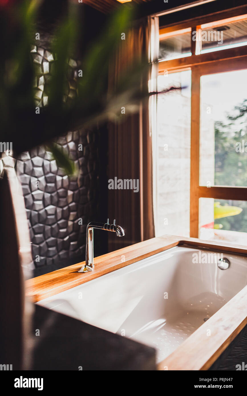 Modern Bathroom With Black Walls, Wooden Decoration And Big Panoramic Window