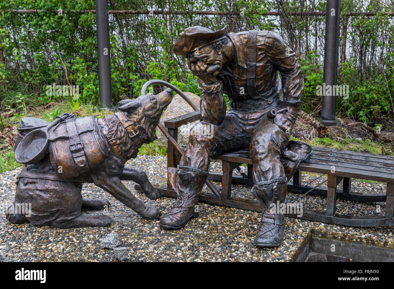 Prospector and  dog sculpture, Skagway, Alaska, United States, USA, Tuesday, May 22, 2018. - Stock Image
