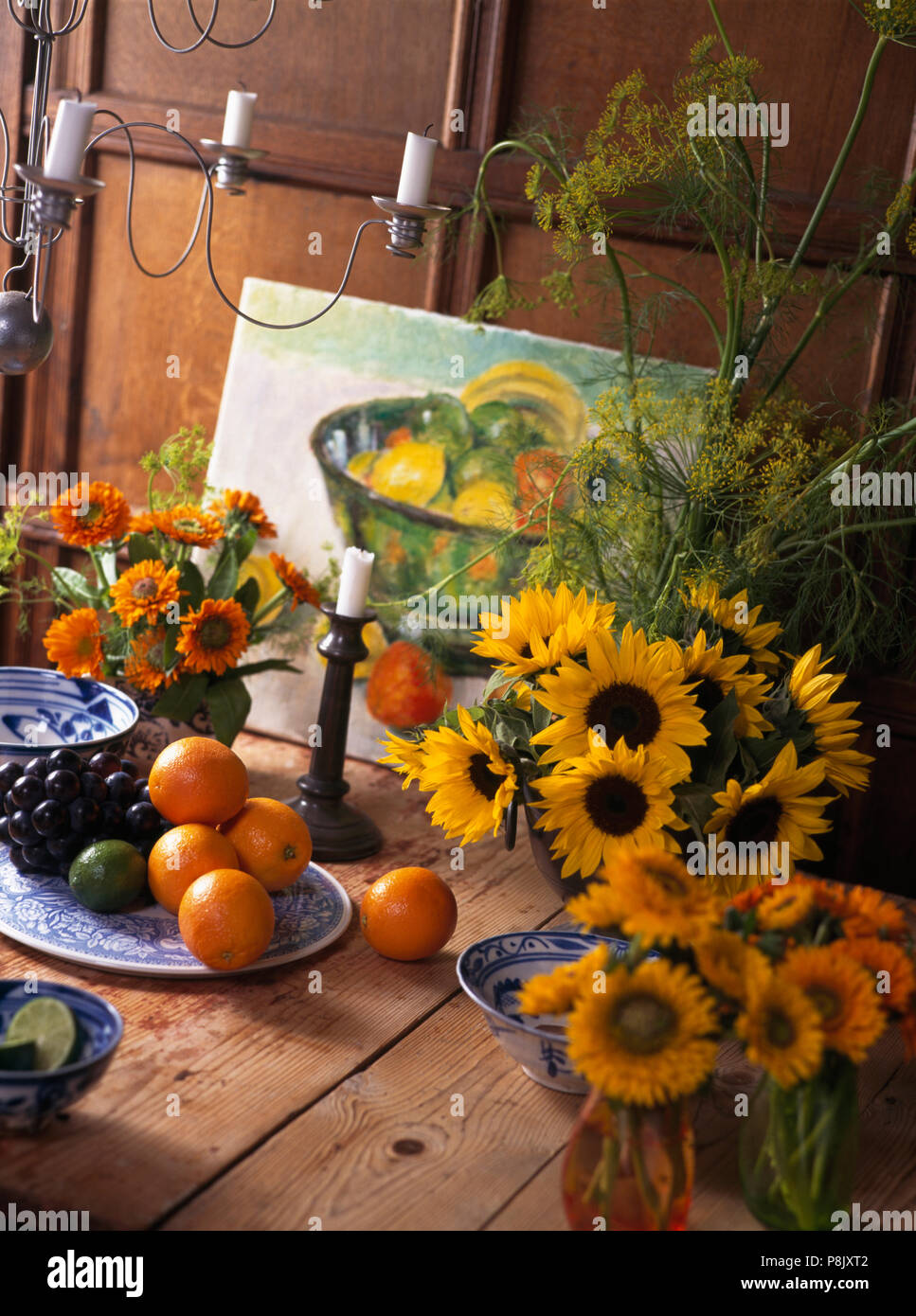 Still Life Of Yellow Sunflowers And Orange Marigolds In Simple Floral Arrangements Stock Photo Alamy