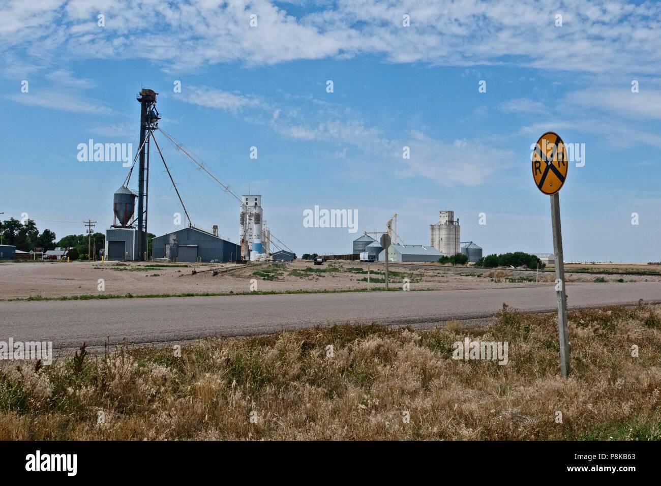 Moscow, Kansas roadside showing grain elevators and grain storage facilities - Stock Image