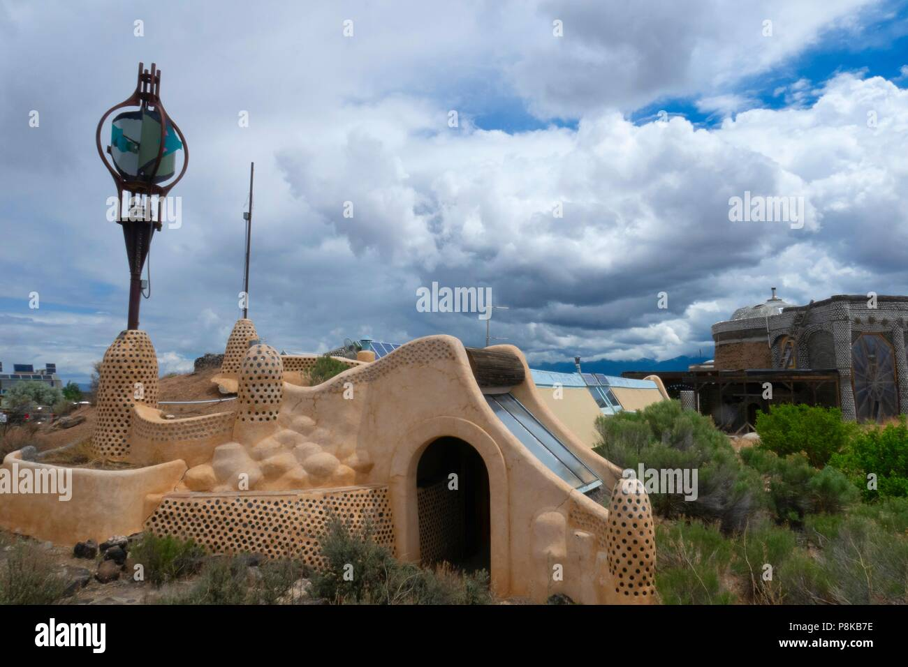 Organic sustainable housing in an earthship community on the outskirts of Taos New Mexico using recycled and sustainable building materials - Stock Image