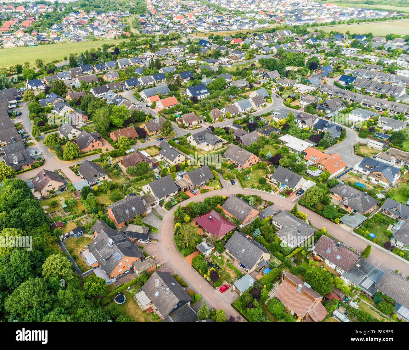 Typical German new housing development in the flat countryside of northern Germany between fields and meadows, made with drone Stock Photo