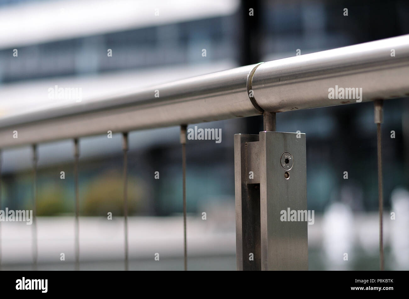 close-up of handrail of a bannister constructed with stainless steel ...