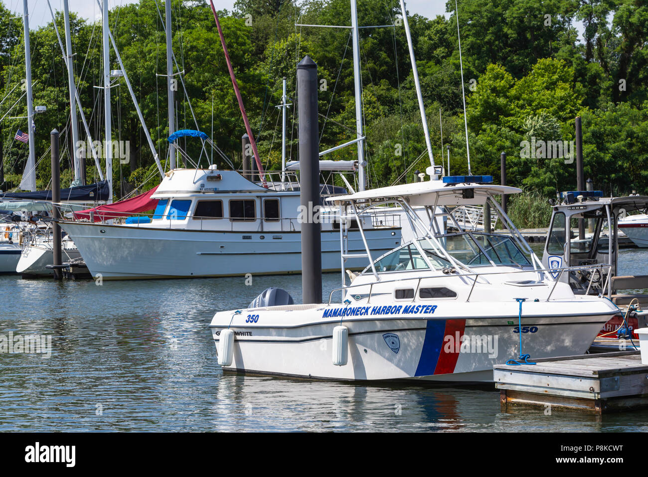 A Mamaroneck Harbor Master's boat docked in the West Basin of Mamaroneck Harbor in Harbor Island Park, Mamaroneck, New York. - Stock Image