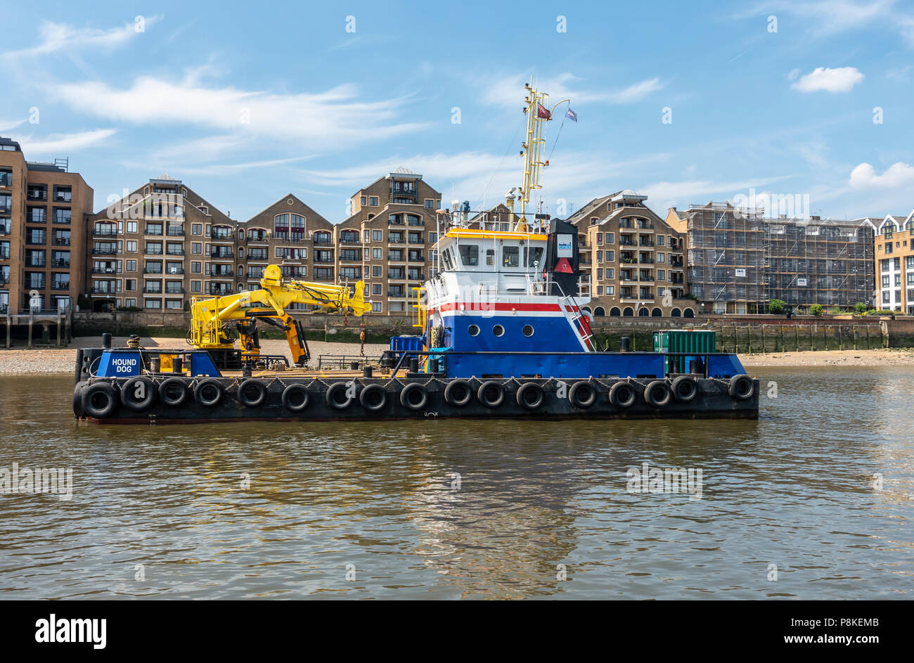 MPV Hound Dog, a multi-purpose vessel with a marine knucklebone crane, two winches, capstan, a towing hook and a bow roller. Docklands, London. - Stock Image