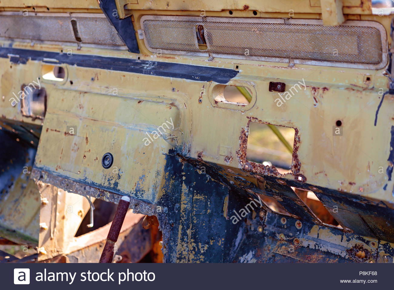 Close up of the interior of an old rusted and abandoned car - Stock Image