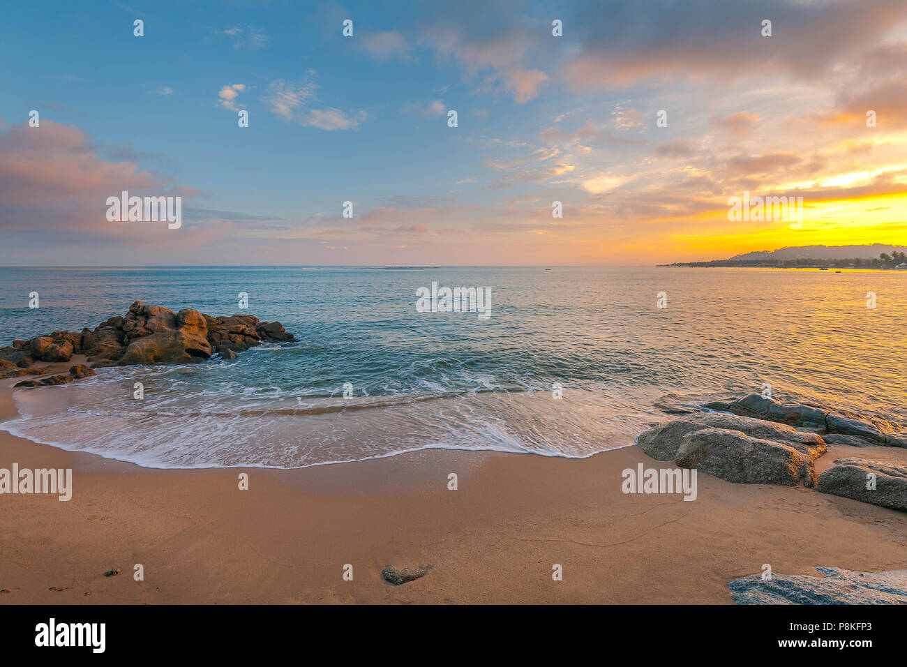 A colorful sunset on the island of Koh Samui in Thailand. - Stock Image