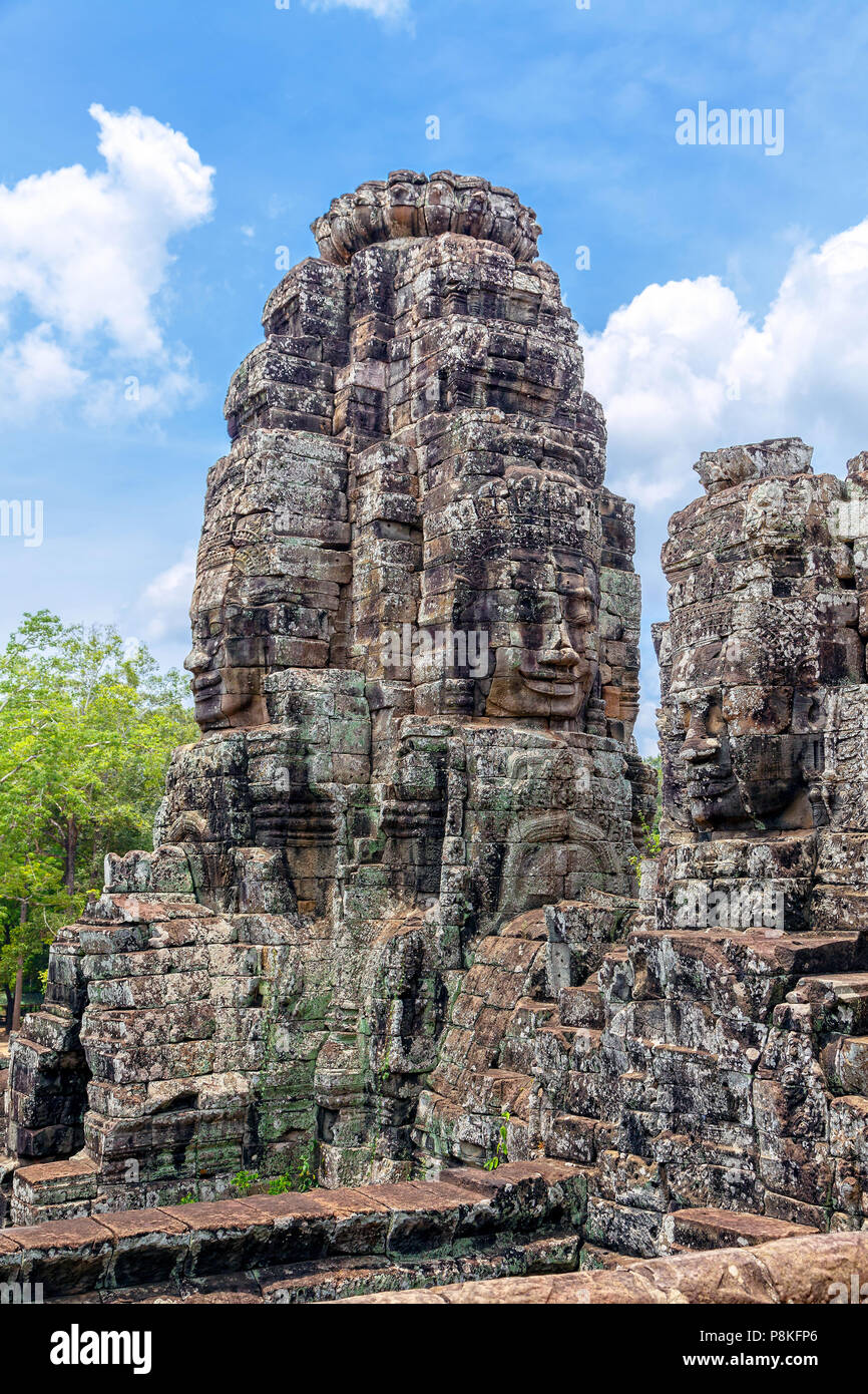 Tower with Buddha images in the temple of Angkor Tom in Cambodia. - Stock Image