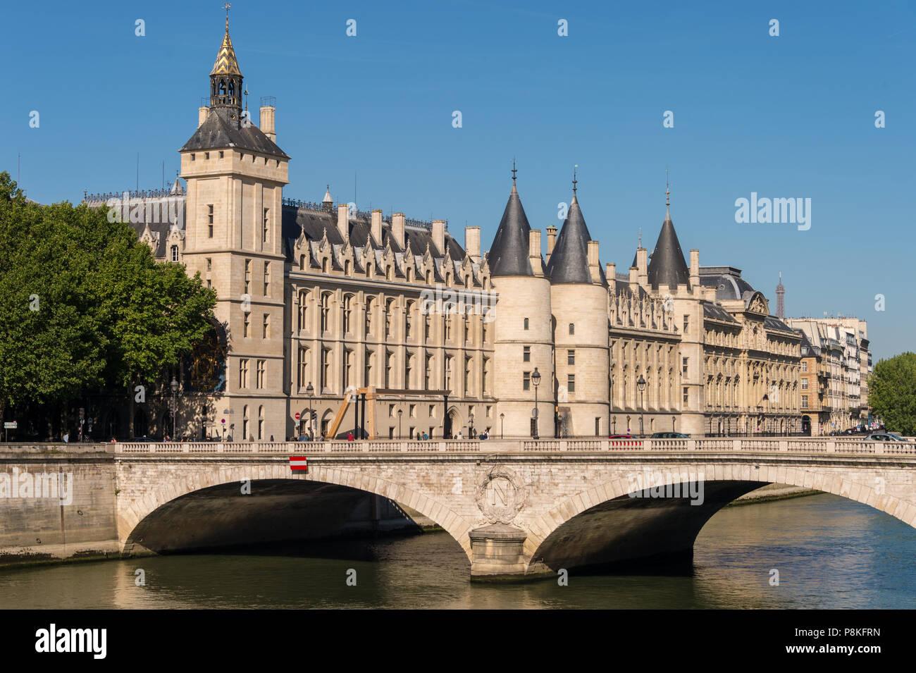 Paris, France - 23 June 2018: The 'Pont au Change' bridge over river Seine and former royal palace and prison 'La Conciergerie' - Stock Image