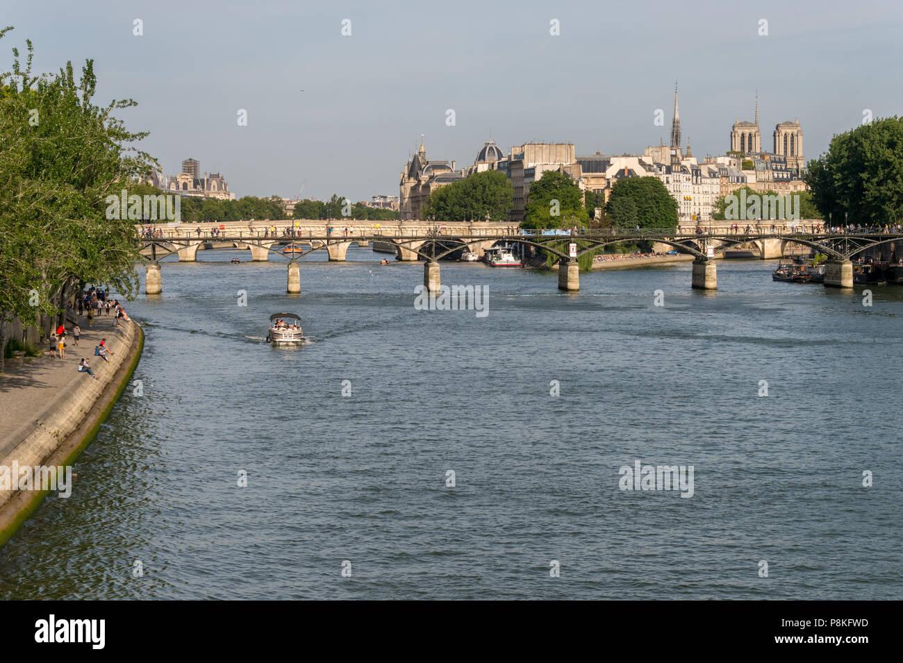 Paris, France - 24 June 2018: View of Pont des Arts, Ile de la Cité, and Notre-Dame Cathedral. - Stock Image