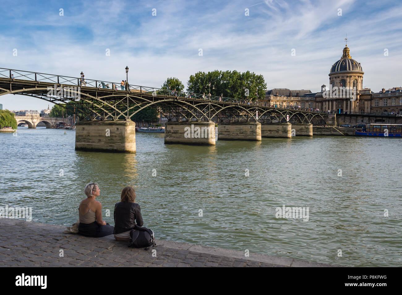 Paris, 24 June 2018: Pont des Arts and Institut de France across Seine river - Stock Image