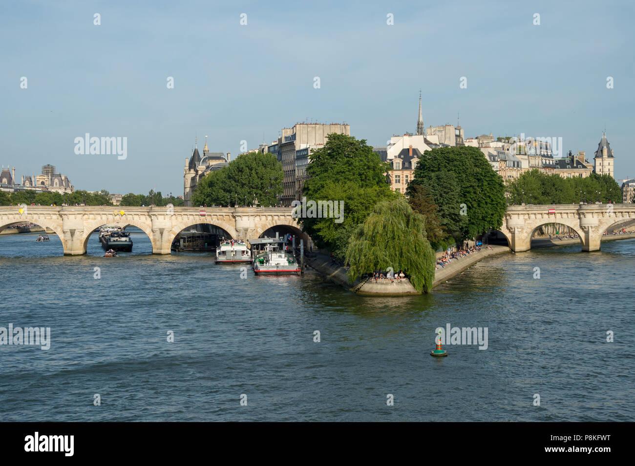 Paris, France - 24 June 2018: Ile de la Cité, Notre-Dame Cathedrale and Square du Vert-Galant from Pont des Arts bridge. - Stock Image
