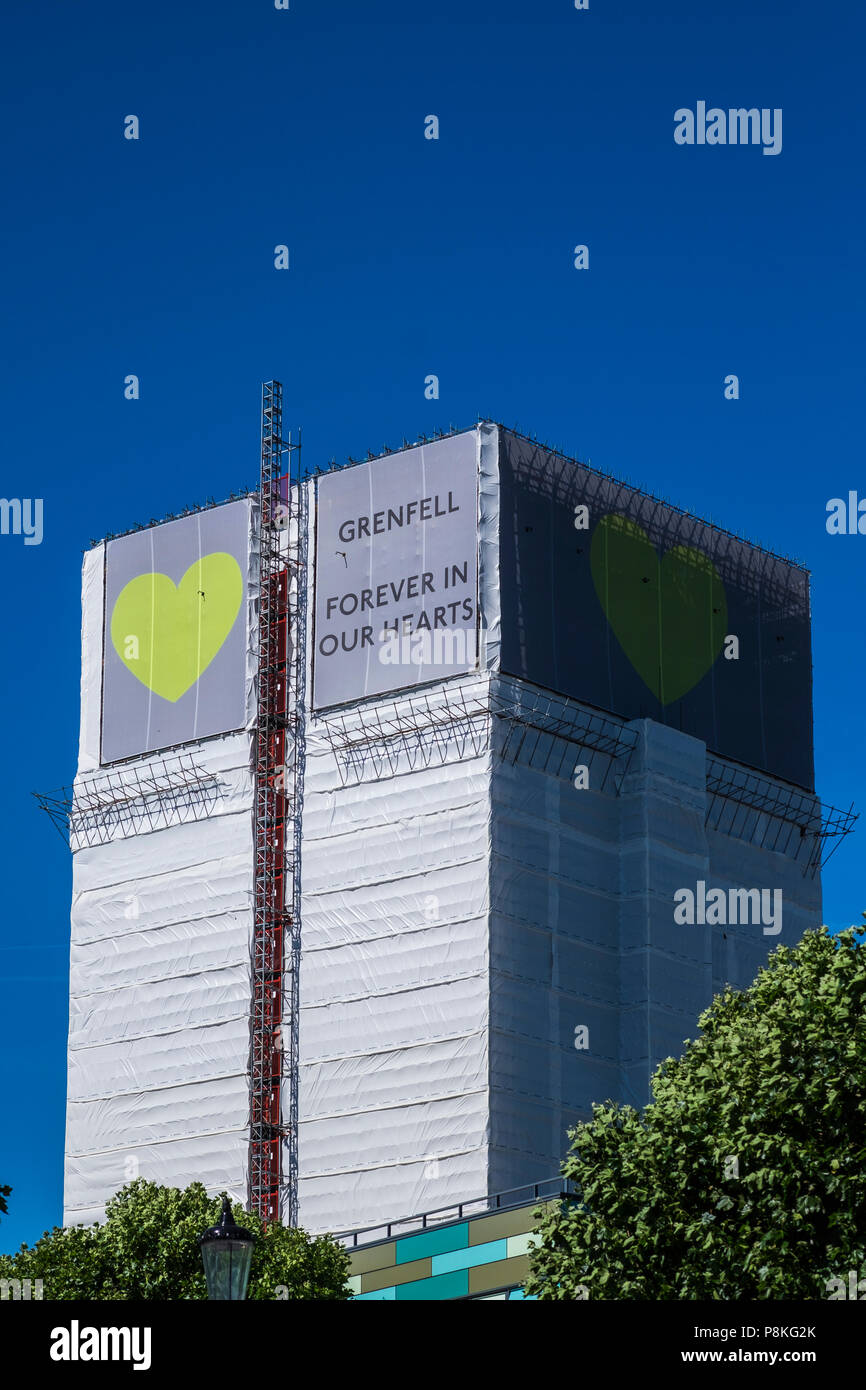 Grenfell Tower covered in plastic sheeting after fire, London, England, U.K. - Stock Image
