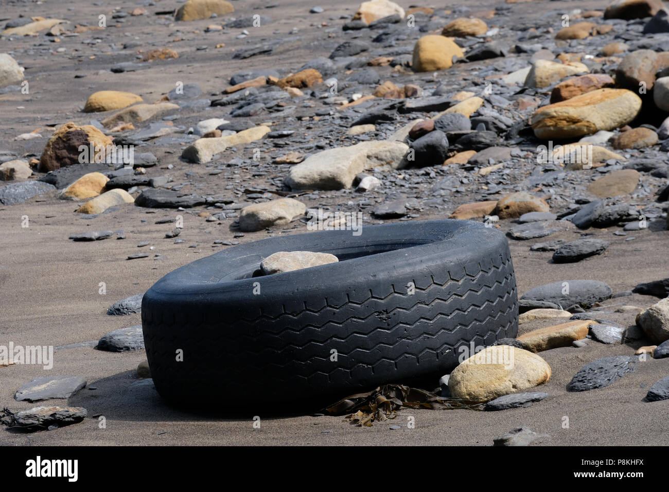 Plastic waste and rubbish washed up on the beaches of Yorkshire's Heritage Coast - Stock Image
