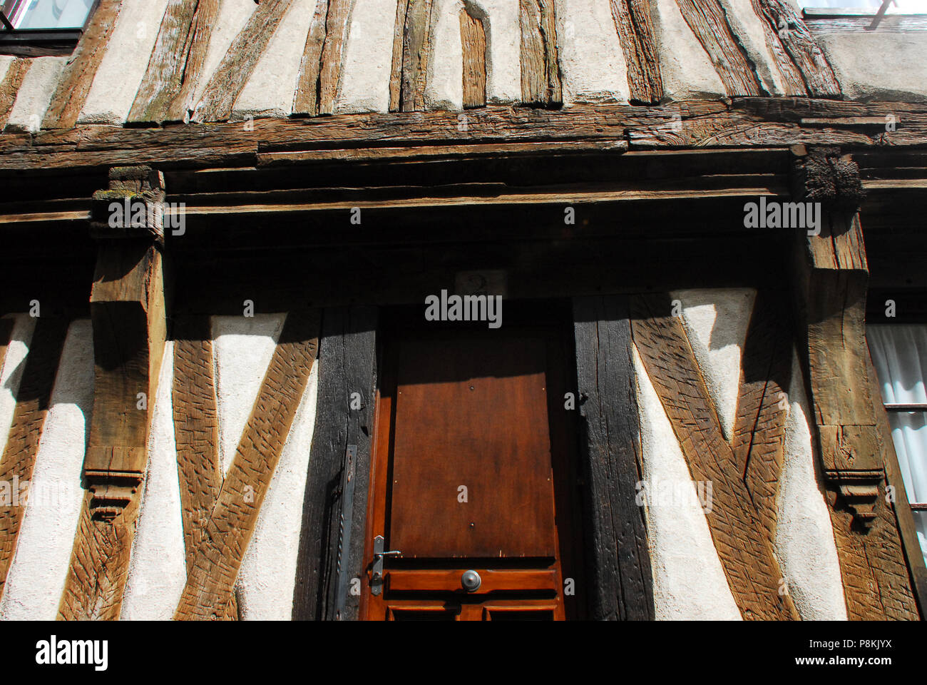Architectural details captured in a close up of this amazing half-timber house in charming Noyers-Sur-Serein, France. - Stock Image