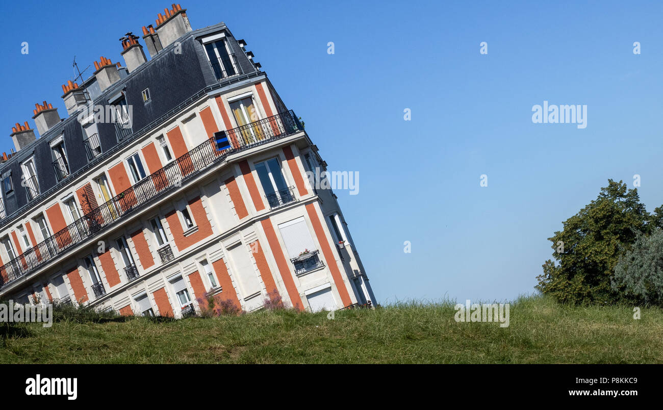 The Sinking house on Montmartre hill, an optical illusion taken from an unusual angle, Paris, France - Stock Image