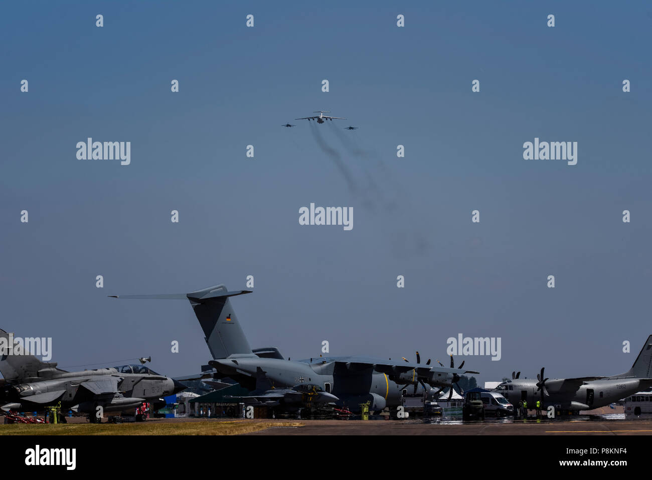 Ukrainian Air Force, an Ilyushin Il-76 tanker transport and two Sukhoi Su-27 Flanker fighters - all Russian built - arriving over RAF Fairford for at Royal International Air Tattoo, RIAT 2018. Transport aircraft below - Stock Image