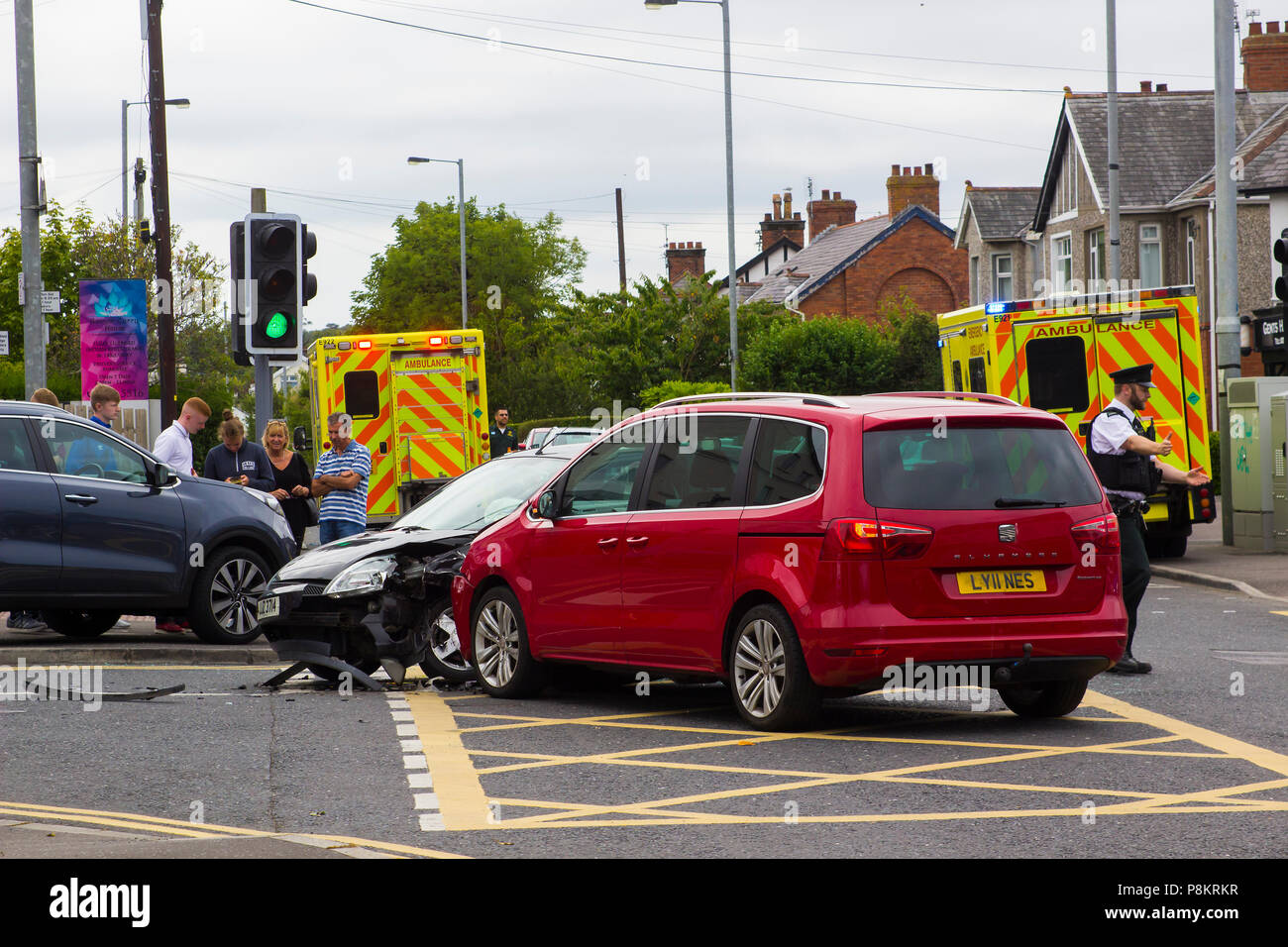 Ballyholme, Northern Ireland. 12th July 2018. A multi vehicle road traffic accident at Ballyholme in Bangor County Ddown Northern Ireland with two ambulances in attendance. details of any injured persons are not yet available but the image shows extensive damge to vehichles with one having mounted the pavement at the entrance to the Windmill Road Credit: MHarp/Alamy Live News Stock Photo