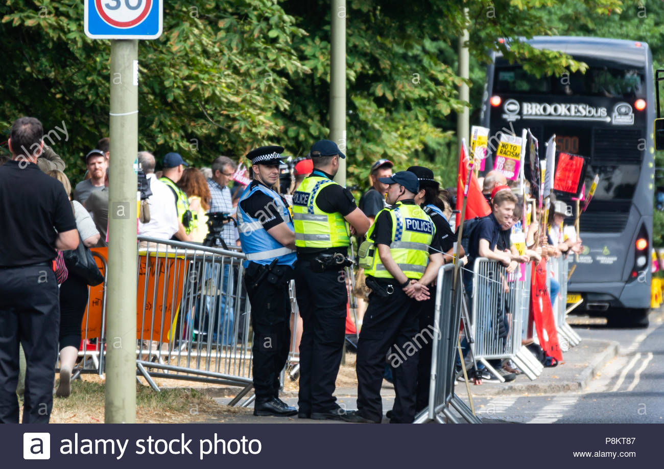 Woodstock July 12th 2018 Protesters gather outside Blenheim palace in advance of the arrival of United States President Donald Trump who joined British Prime Minister Theresa May for a black-tie dinner at Blenheim Palace, Churchill's birthplace near Oxford, at the start of his trip to England. Bridget Catterall Woodstock, UK  Alamy Live News - Stock Image