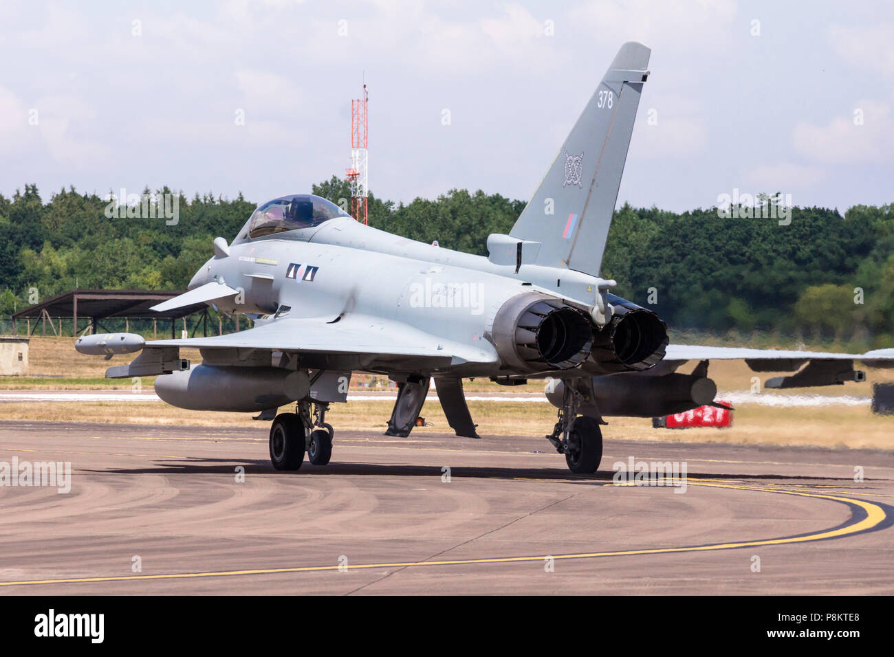 12th July 2018. Aircraft arrive for the 2018 air show which takes place over 3 days (13th to the 15th July). Invitations went out to airforces all over the world, many have accepted and the display and support aircraft have ben arriving all week. Some just do a flypast and land but sevaral exciting displays were put on. an RAF typhoon ©JMF News / alamy Live News - Stock Image