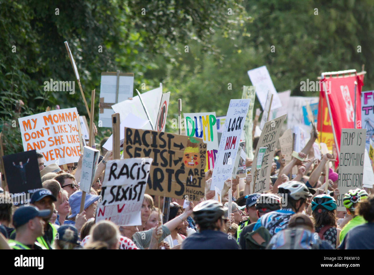 Woodstock, Oxford, UK 12th July 2018. Hundreds  protest at the gate of Blenheim palace as   President Donald Trump's attends a  black tie dinner hosted by Prime Minister Theresa May. © Pete Lusabia/Alamy News Live - Stock Image