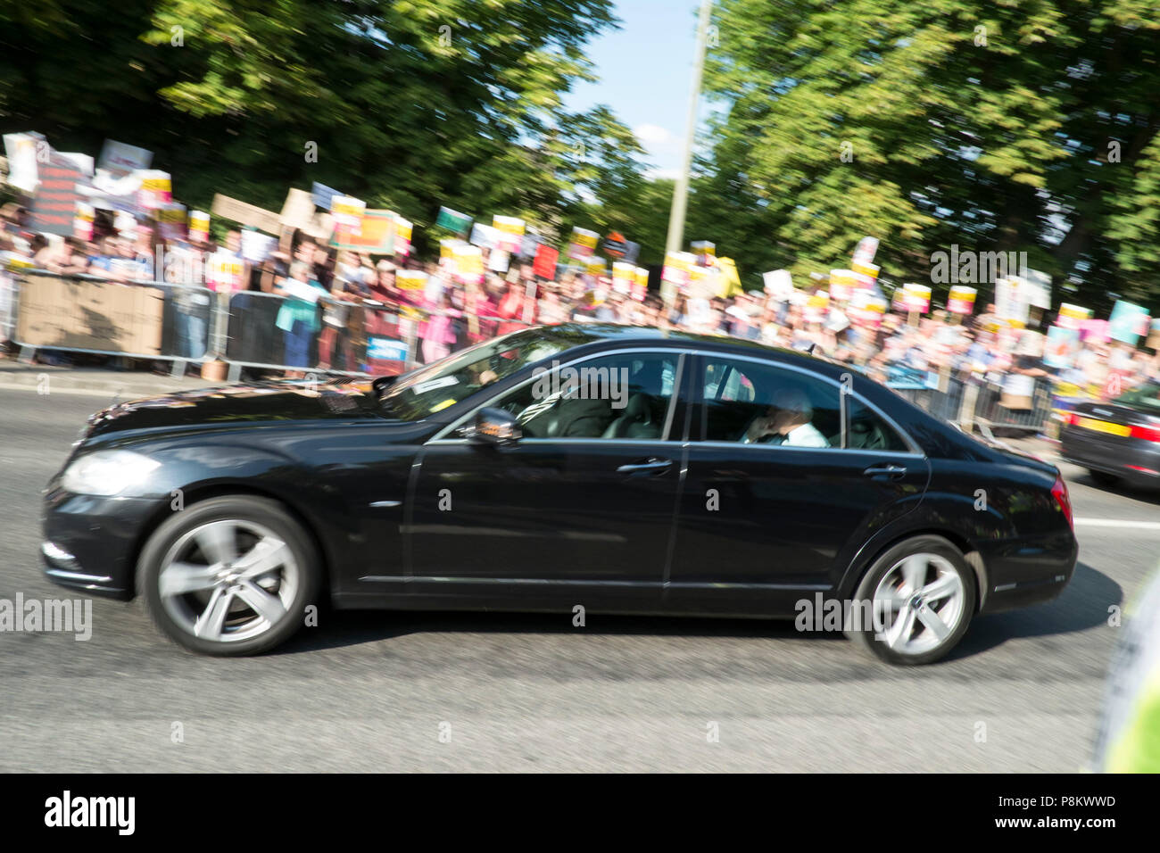 Guests arrive for dinner at Blenheim with President Trump.  They had to pass through a large crowd of well over two thousand shouting protestors who voiced their displeasure at the President's visit. Credit: adrian arbib/Alamy Live News - Stock Image