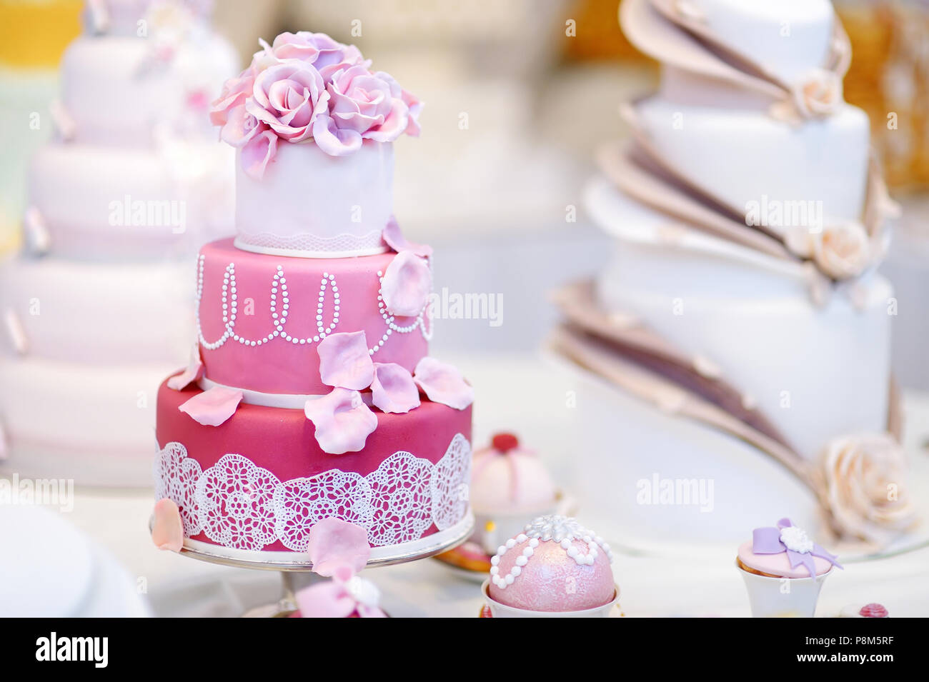 White Wedding Cake Decorated With Pink Sugar Flowers Stock Photo