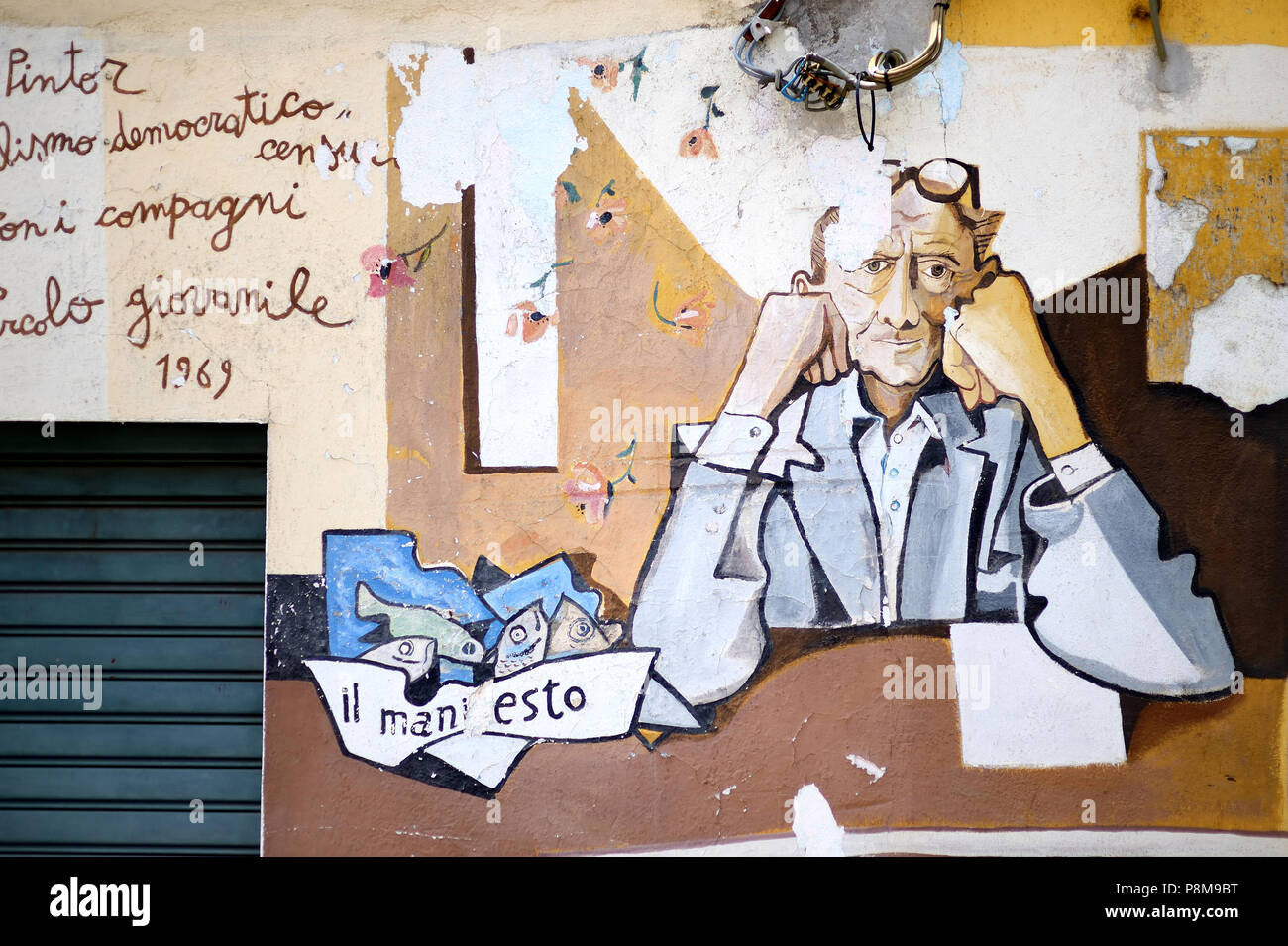 ORGOSOLO, ITALY - MAY 21, 2014: Murals wall paintings about political and historical facts in Orgosolo, Sardinia, Italy Stock Photo