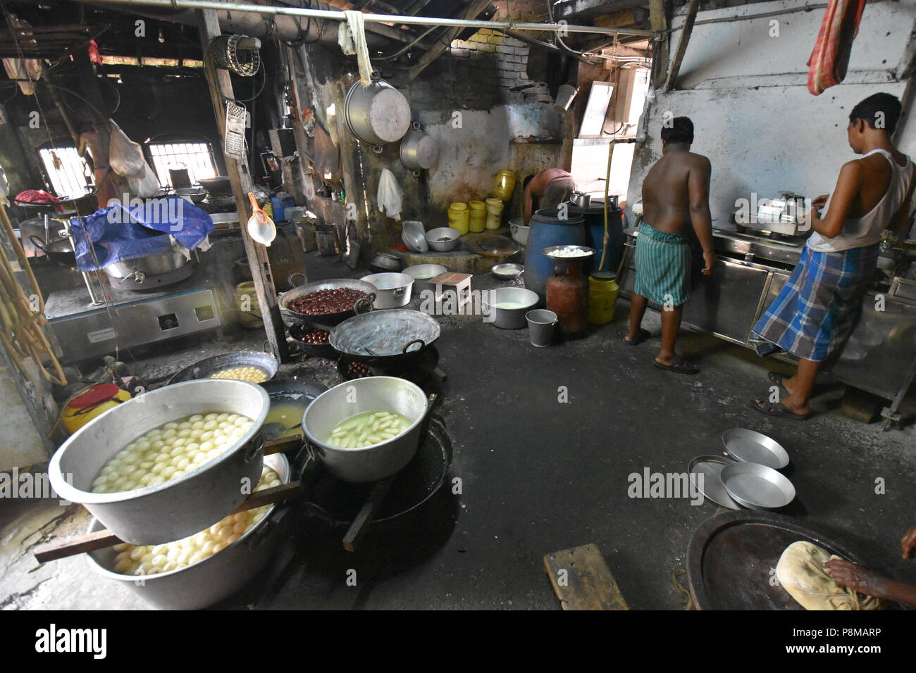 Shitala Mistanna Bhandar (A Bengali sweet house) kitchen, Batai zero-point, Amta, Howrah, West Bengal, India - Stock Image