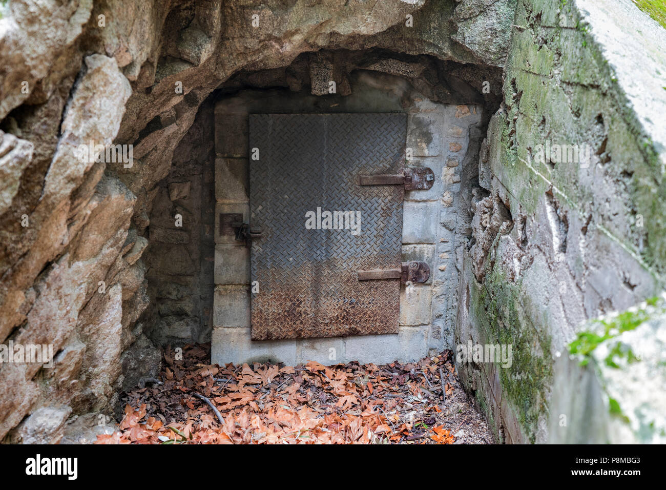 Old mine entrance metal door in the Angeles National Forest area of the popular San Gabriel Mountains above LA and Pasadena California. - Stock Image