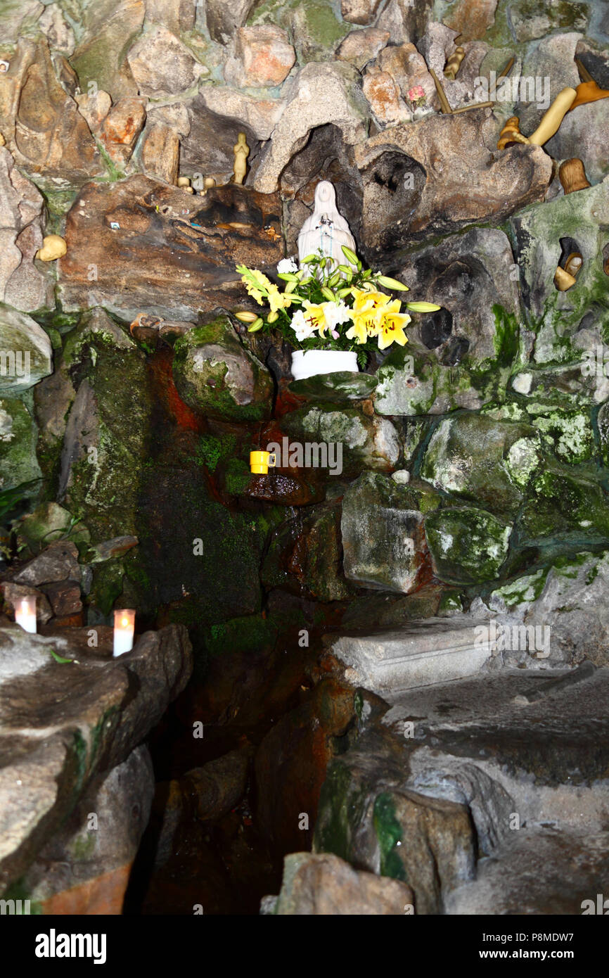 Virgen of Lourdes statue, spring and wax body parts in grotto on Monte do Calvario, Vila Praia de Ancora, Minho Province, northern Portugal - Stock Image