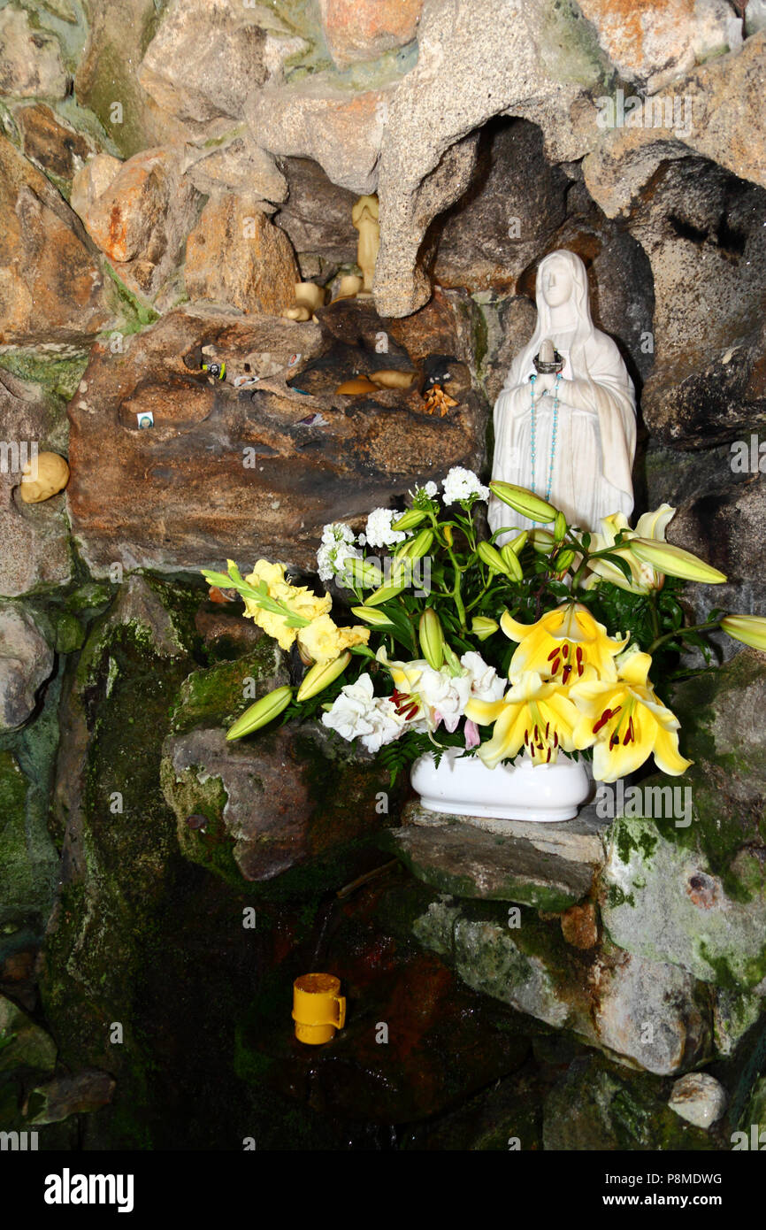 Virgen of Lourdes statue and spring in grotto on Monte do Calvario, Vila Praia de Ancora, Minho Province, northern Portugal - Stock Image