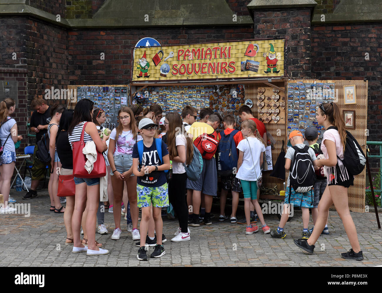 School children buying souvenirs gifts in Wroclaw, Silesia, Poland, Europe - Stock Image